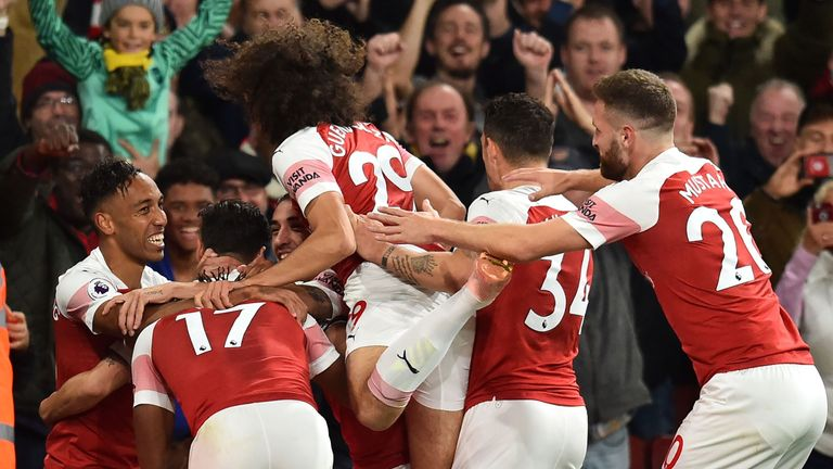 Arsenal's Pierre-Emerick Aubameyang celebrates with teammates after scoring their third goal during the English Premier League football match between Arsenal and Leicester City at the Emirates Stadium in London.