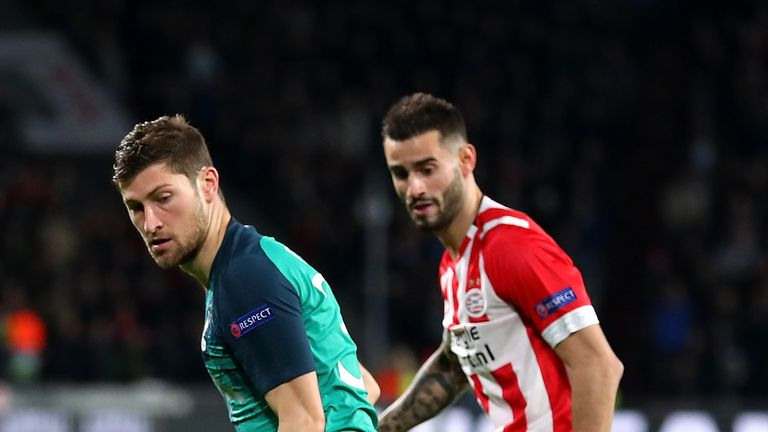 Ben Davies of Tottenham Hotspur is challenged by Gaston Pereiro of PSV Eindhoven