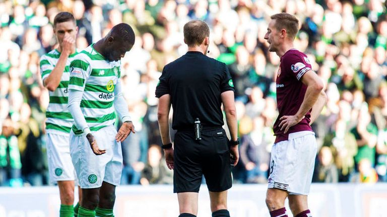 Kouassi complains to referee Kevin Clancy after the coming together
