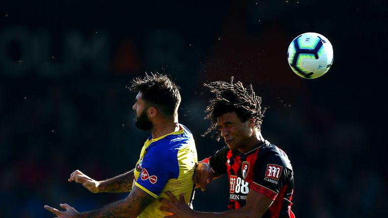 Charlie Austin and Nathan Ake clash heads in one of several stoppages