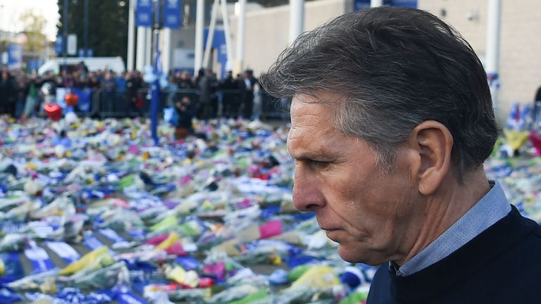 Leicester manager Claude Puel observes the tributes and messages to Leicester owner Vichai Srivaddhanaprabha