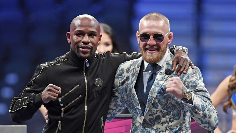 Floyd Mayweather Jr. Conor McGregor in the round of their super welterweight boxing match at T-Mobile Arena on August 26, 2017 in Las Vegas, Nevada. Mayweather won by 10th-round TKO.