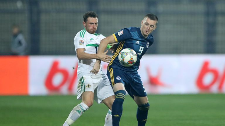 Corry Evans and Haris Duljevic battle for possession during the match in Sarajevo