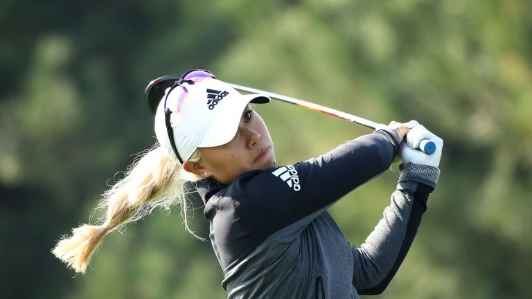 Danielle Kang sits alongside Hull after mixing six birdies with two early bogeys