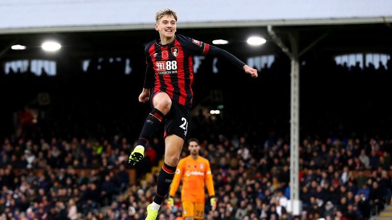 David Brooks celebrates after doubling Bournemouth's lead at Craven Cottage