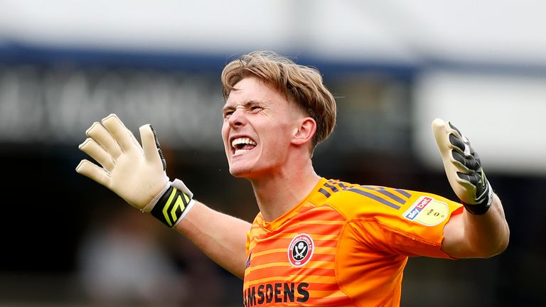Dean Henderson celebrates Sheffield United's victory over QPR