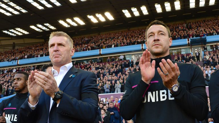 Aston Villa head coach Dean Smith and assistant John Terry during the minute's applause for the late Sir Doug Ellis at Villa Park,