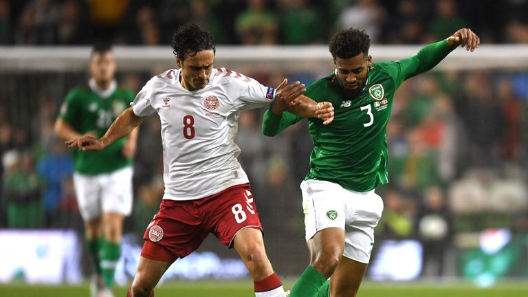 Thomas Delaney battles for the ball with Cyrus Christie