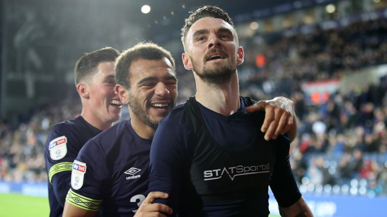 Derby County's Scott Malone (right) celebrates scoring his side's fourth goal