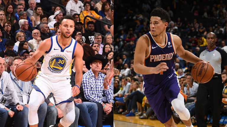devin booker and stephen curry in their match suns v warriors