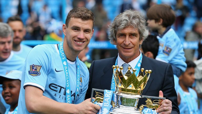 Edin Dzeko and Manuel Pellegrini pose with Premier League trophy