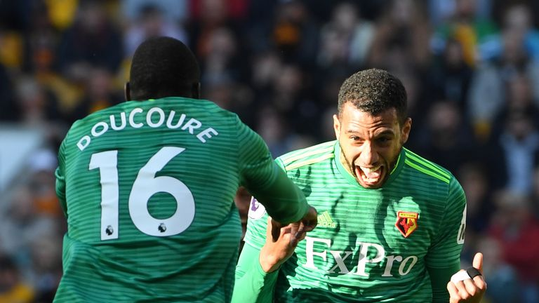Etienne Capoue celebrates with Abdoulaye Doucoure after scoring his team's first goal