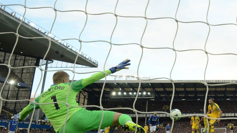Everton's English goalkeeper Jordan Pickford (2nd L) reacts after saving a penalty taken by Crystal Palace's Serbian midfielder Luka Milivojevic (not pictured) during the English Premier League football match between Everton and Crystal Palace at Goodison Park in Liverpool, north west England on October 21, 2018