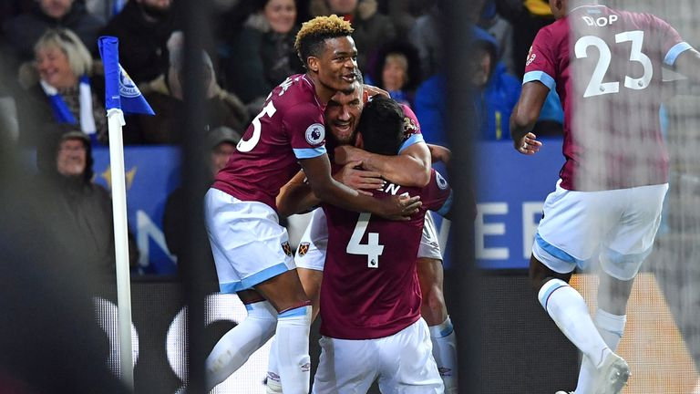 Fabian Balbuena (C) celebrates with team-mates after scoring the opening goal of the game