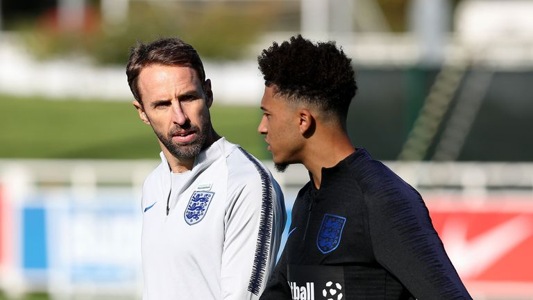 England manager Gareth Southgate with Jadon Sancho during training at St George's Park