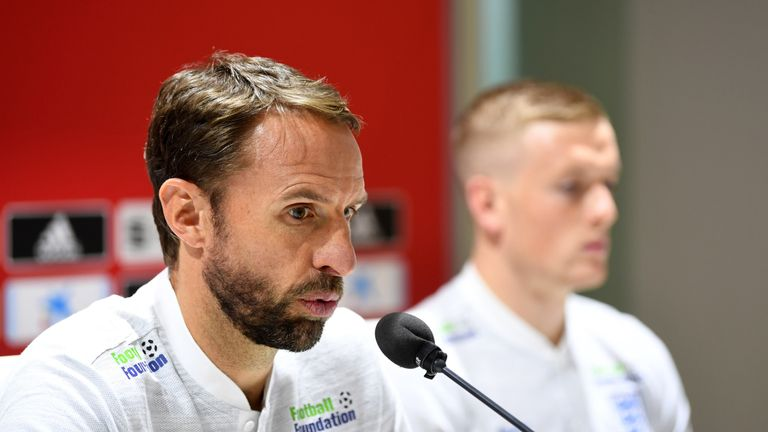 Gareth Southgate, Manager of England and Jordan Pickford of England attend an England press conference ahead of their UEFA Nations League match against Spain at Estadio Benito Villamarin on October 14, 2018 in Seville, Spain