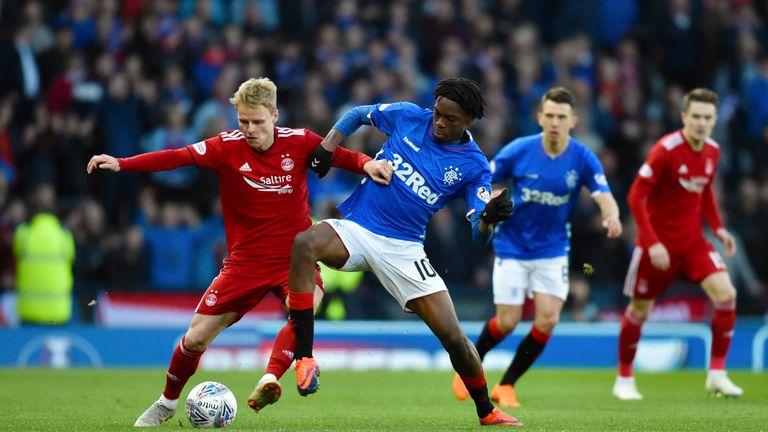 Aberdeen's Gary Mackay-Steven (left) holds off Rangers' Ovie Ejaria