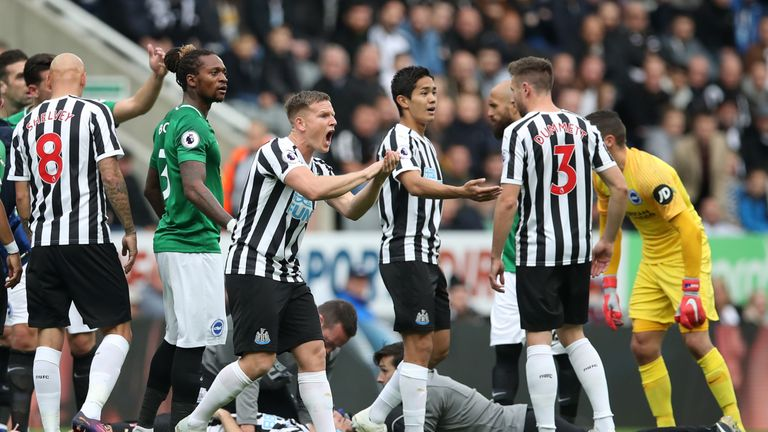 Players call for a stretcher after a clash of heads between Glenn Murray and Federico Fernandez