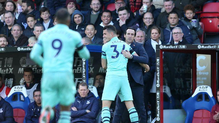 Emery celebrates with Granit Xhaka after the Swiss' stunning free-kick against Palace