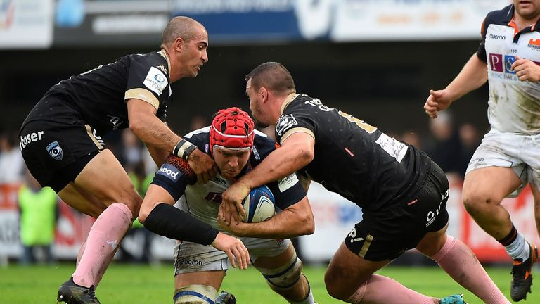 Edinburgh's Grant Gilchrist is double tackled in a show of resilience by Montpellier