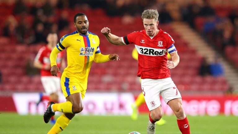 Middlesbrough's Grant Leadbitter battles for possession with Palace winger Jason Puncheon (left)