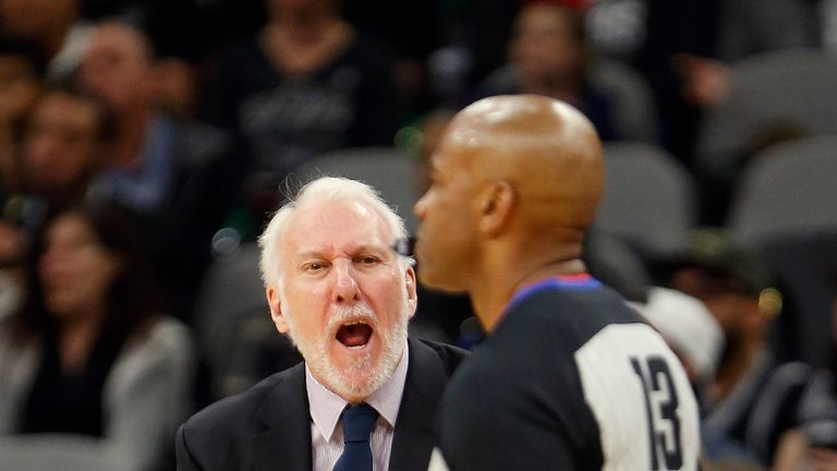 San Antonio Spurs head coach Gregg Popovich shouts in the direction of NBA official Tre Maddox after a travel was not called