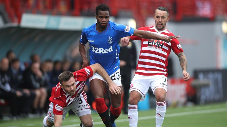 Scott McMann of Hamilton Academical vies with Lassana Coulibaly of Rangers