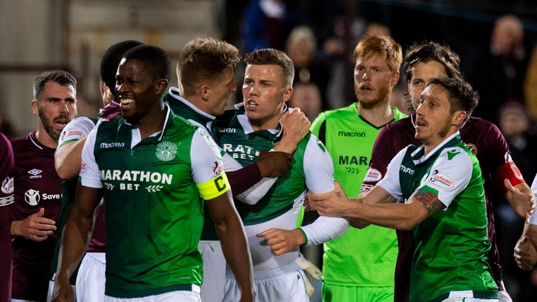 Hibernian's Florain Kamberi is held back by his teammates