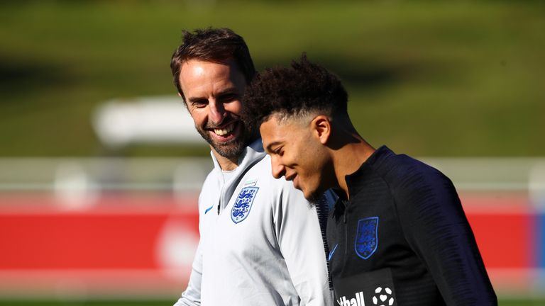 Jadon Sancho with Gareth Southgate during an England Training Session at St Georges Park on October 9, 2018 in Burton-upon-Trent, England.