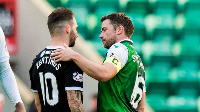 Hamilton's James Keatings is consoled by former team mate Lewis Stevenson after their 6-0 defeat to Hibernian