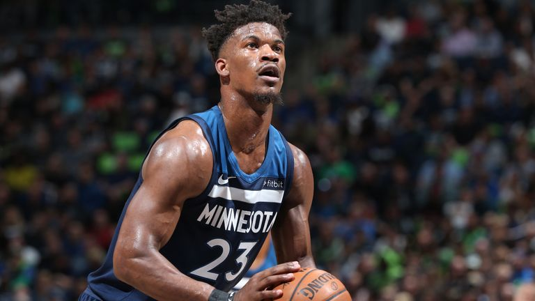 Jimmy Butler #23 of the Minnesota Timberwolves shoots a free throw against the Houston Rockets