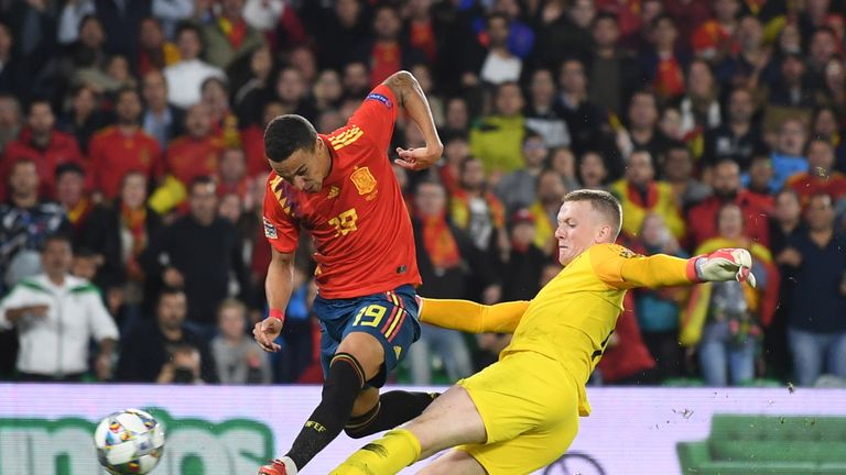 Jordan Pickford tackles Rodrigo after being dispossessed in his own area