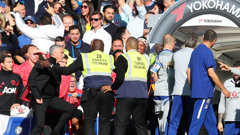 Jose Mourinho reacts to a member of Chelsea's backroom staff after their stoppage-time equaliser
