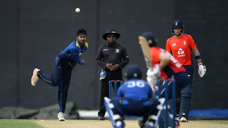 Kamindu Mendis bowled right-arm off-breaks to Eoin Morgan...