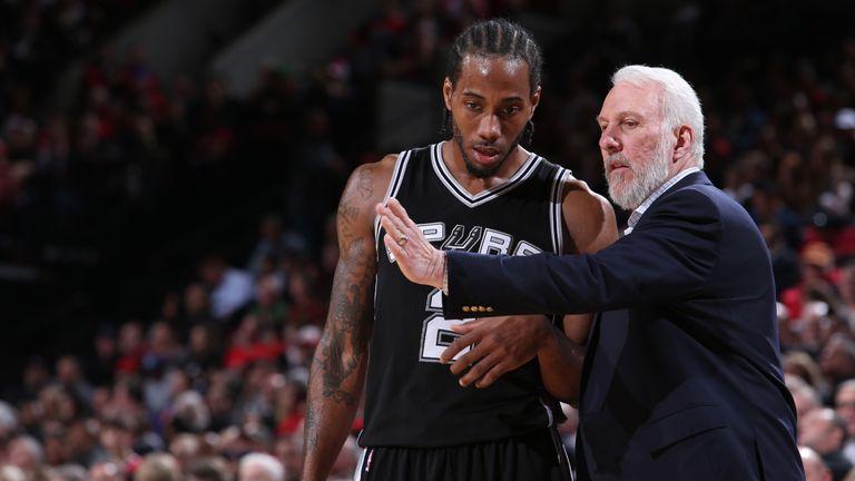 Kawhi Leonard #2 and Gregg Popovich of the San Antonio Spurs talk against the Portland Trail Blazers on December 15, 2014 at the Moda Center Arena in Portland, Oregon.