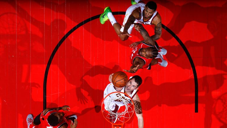 Kevin Love of the Cleveland Cavaliers and Kawhi Leonard #2 of the Toronto Raptors go for a rebound on October 17, 2018 at Scotiabank Arena in Toronto, Ontario, Canada
