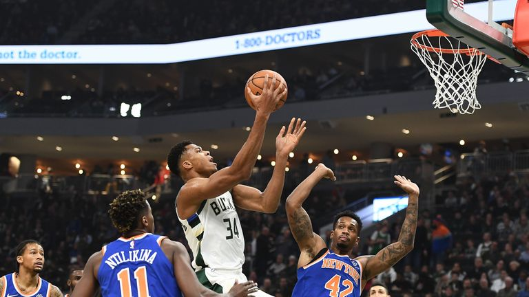 Giannis Antetokounmpo #34 of the Milwaukee Bucks drives to the basket against Lance Thomas #42 of the New York Knicks during the first half of a game at the Fiserv Forum on October 22, 2018 in Milwaukee, Wisconsin.