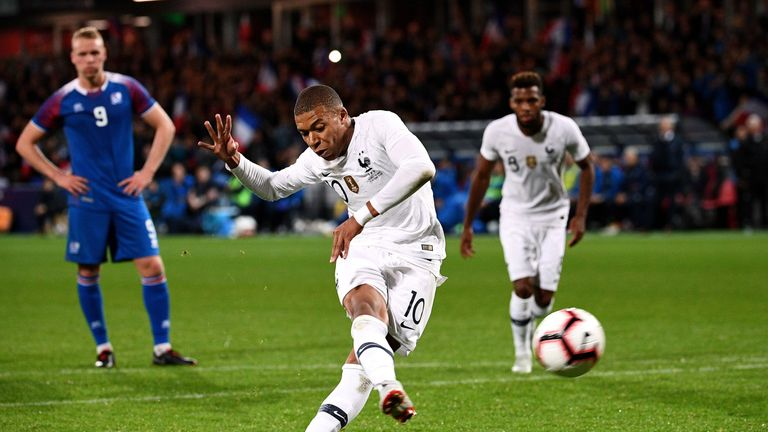 Kylian Mbappe scored from the spot to rescue a draw for France