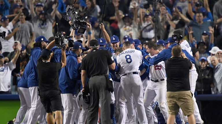 The Dodgers celebrate their Game Three win to reduce the Boston Red Sox's lead in the World Series to 2-1