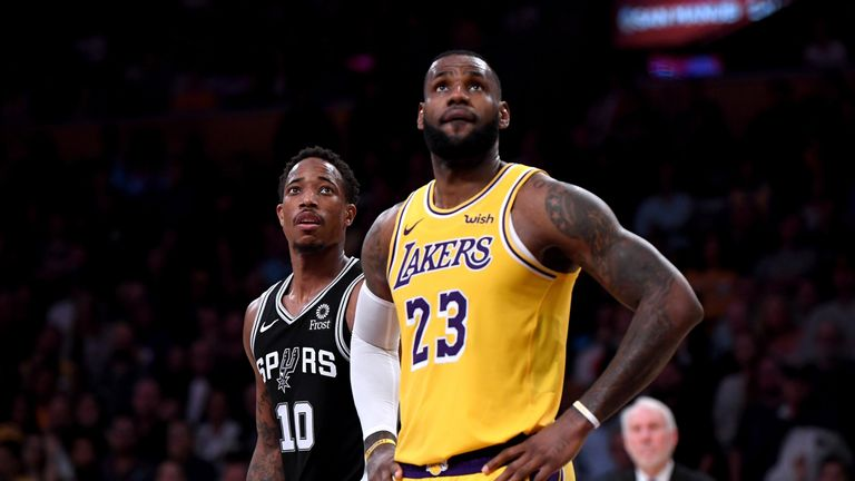 DeMar DeRozan #10 of the San Antonio Spurs and LeBron James #23 of the Los Angeles Lakers watch a freethrow during a 143-142 Spurs win at Staples Center on October 22, 2018 in Los Angeles, California.