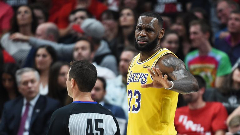 LeBron James #23 of the Los Angeles Lakers argues with referee Brian Forte #45 in the second quarter of their game against the Portland Trail Blazers at Moda Center on October 18, 2018 in Portland, Oregon.