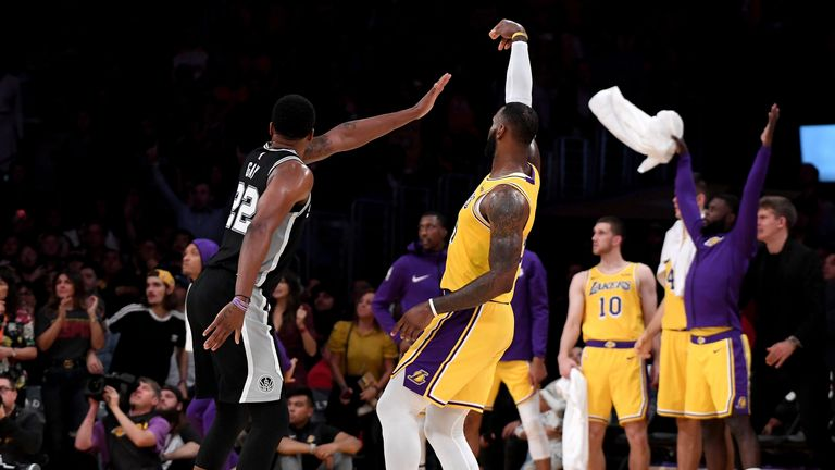 OCTOBER 22: LeBron James #23 of the Los Angeles Lakers makes a three pointer in front of Rudy Gay #22 of the San Antonio Spurs to tie the game 128-128 during a 143-142 overtime Laker loss at Staples Center on October 22, 2018 in Los Angeles, California.