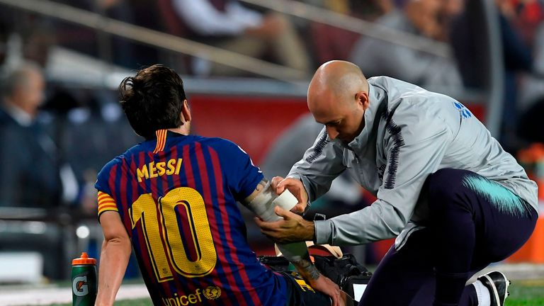 Messi scores, assists, breaks arm in first 16 minutes
