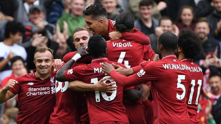Liverpool's German-born Cameroonian defender Joel Matip celebrates with teammates after scoring the team's second goal during the English Premier League football match between Liverpool and Southampton at Anfield in Liverpool, north west England on September 22, 2018.