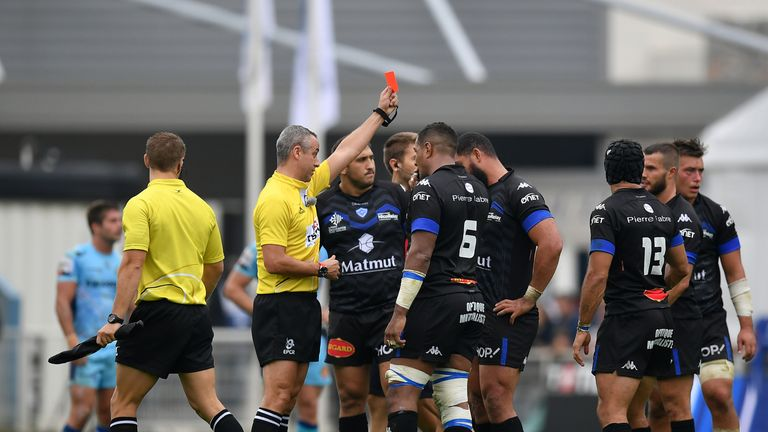 Ma'ama Vaipulu of Castres is shown a red card for a high tackle