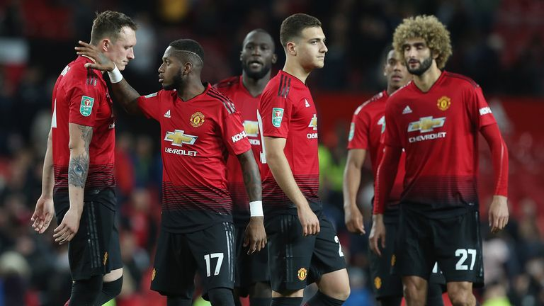 Phil Jones of Manchester United is consoled by Fred after missing a penalty during a shoot out during the Carabao Cup Third Round match between Manchester United and Derby County at Old Trafford on September 25, 2018 in Manchester, England.