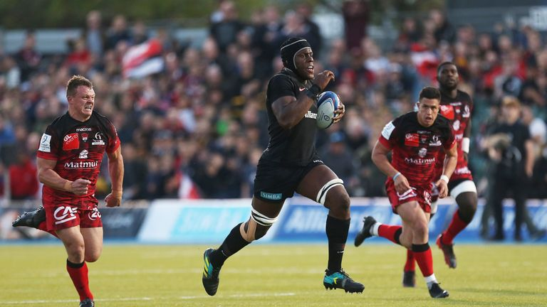 Maro Itoje breaks away for a try against Lyon at Allianz Park