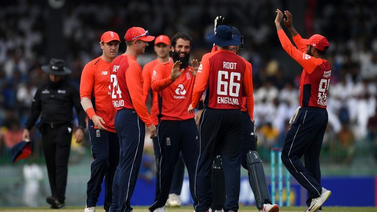 Moeen Ali of England celebrates with team-mates after dismissing Niroshan Dickwella
