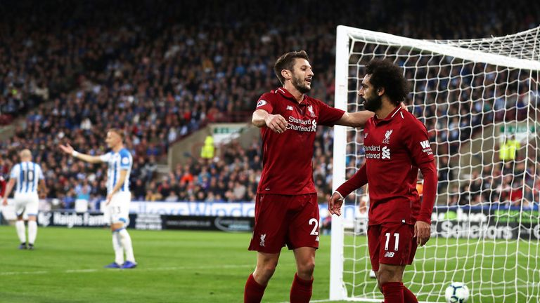 Mohamed Salah is congratulated by Adam Lallana after putting Liverpool 1-0 up