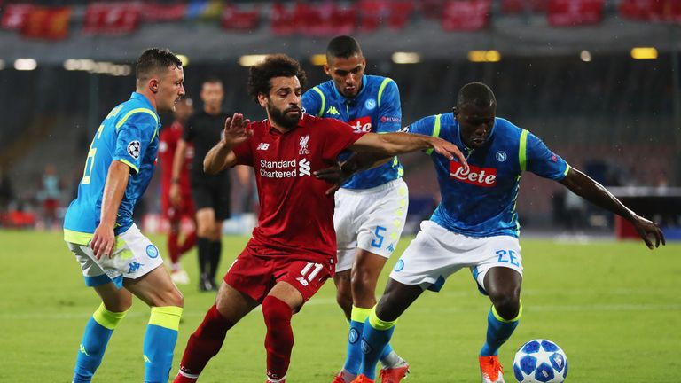 Mohamed Salah is surrounded in Napoli